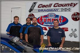 Joe Newsham and jandeperformance In The Winners Circle At Cecil County Dragway